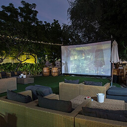 Relax in an outdoor cinema orchard at Reform Social & Grill (via Time Out Dubai)